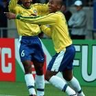 Brazil's Leonardo (right) celebrates his hat trick with team-mate Anderson during the Fifa Under...