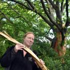 Shelli Mears holds a piece of a 100-year-old oak tree on her Palmerston farm that was hit in a...