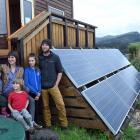Jennifer Shulzitski and Geoff Clarke with children (from left) Silas Clarke (4), Odin Higbee (7)...