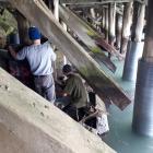 As crews worked to repair severely deteriorated wooden piles under Holmes Wharf, in Oamaru, in...