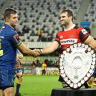 Captains Michael Collins (left) and Luke Whitelock shake hands as Otago hand the Ranfurly Shield...