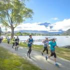 Competitors in the Queenstown International Marathon get distracted by the view. Photo: Ross Mackay