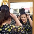 Anna Fitzgerald (21), of Dunedin, looks for a new fascinator to wear to the Harcourts Melbourne...