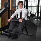 Mark Smith (15) has a go on a rowing erg at John McGlashan College this week after setting a...