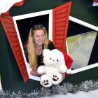 Santa Parade Trust chairwoman Michelle Ellwood in the Santa's Workshop float, which will carry...