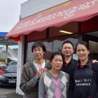Maori Hill Takeaways former owners Chingwah (left) and Alice Cheung (second from left) and new...