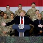 US President Donald Trump delivers remarks to US troops, with Afghanistan President Ashraf Ghani...