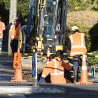 Workers from Citycare at work in Taieri Rd above Wakari Hospital after reports of a burst water...
