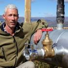 Otago Regional Councillor Gary Kelliher shows a firehose fitting that has been added to the Dairy...