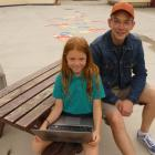 Goldfields Primary School pupil Rose Deegan (8) holds a recycled laptop alongside her dad, Ben...