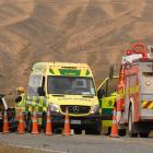 Emergency services at the scene after a car rolled on Omakau-Chatto Creek Rd this morning. Photo:...