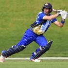 Otago batsman Anaru Kitchen flays another delivery during his innings of 143 not out in the Volts...