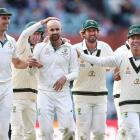 Nathan Lyon (centre) is congratulated by team mates as he helps Australia to a win over Pakistan...