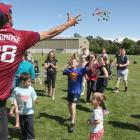 Match official Marc Phillips throws handfuls of lollies for the children at the South Otago...