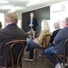 DairyNZ chief executive Tim Mackle discusses the dairy sector with farmers at the Oamaru '...