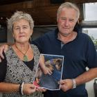 Jane Abbott and her husband Bill hold a picture of Alfie, who was mauled and killed by two dogs...