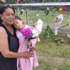 At the cordon in Whakatane, Katerina McLean, left, and Kymani Mihaka, 6, are supporting whānau...