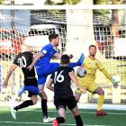 Garghan Coughlan scores for Southern United as Hawke's Bay United players (from left) Bill...
