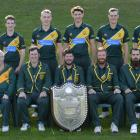 The champion Green Island cricket team. Dion Lobb is in the centre propping up the Bing Harris...