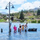 Many young people were enjoying the new, temporary water playground along Lake Wanaka yesterday....