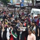Hundreds of University of Otago graduands move along George St on Saturday before two graduation...