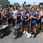 The 2020 Highlanders squad prepares to lend a hand at Orokonui Ecosanctuary yesterday. Photo:...