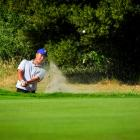 Otago No1 Inia Logan hits the ball out of a bunker in the interprovincial final in Hastings on...