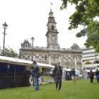 The Dunedin Octagon Market moved to the upper lawn yesterday as preparations for New Year...