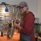 Mike Jacobsen loves working on saxophones, particularly old ones such as this 90-year-old tenor...