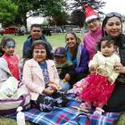 Preparing to celebrate Christmas together are (from left) Rhiya (4, front left), Divinesh Naicker...