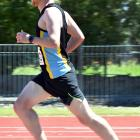 Oliver O'Sullivan on the way to winning the Otago 10,000m championship at the Caledonian Ground...