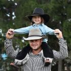 Sam Church gives Jenna Jowett a better view during the 2019 Maniototo Rodeo at the Maniototo...