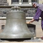 University of Otago Muslim chaplain Salmah Kassim rings the bell to mark handing in her PhD...