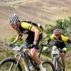 Michael Vink (left) and Tim Rush put the speed on in the Pioneer race in Bannockburn yesterday...