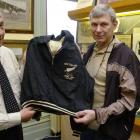 New Zealand Sports Hall of Fame chief executive Ron Palenski (left) accepts the tracksuit top...