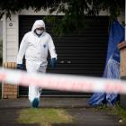 Police at a property in Papatoetoe, South Auckland, where the bodies of a man and woman were...
