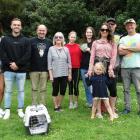 Handing over their Christmas money to Dunedin Wildlife Hospital Trust chairman  Steve Walker ...