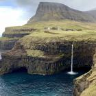 The tiny village of Gasadalur on the island of Vagar is near what's become one of the most famous...