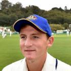 Waitaki Boys' High School pupil Nathan Smith takes a break from the 12th-man duties during Otago...