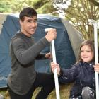 Setting up their campsite at Whare Flat yesterday were Corey Leathart-Sutherland (15) and Ruby...