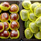 Fruit packaged in plastic on display at a supermarket in Beijing. Photo: Reuters