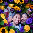Flowers and photos of Kobe Bryant and his daughter Gianna have been placed near the Staples...
