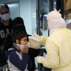 Passengers coming from China are checked by Saudi Health Ministry employees upon their arrival at...