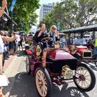 Race starter Dunedin city councillor Lee Vandervis (left) waves away the first veteran car, a...