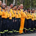 NSW RFS volunteer s make an honour guard for Andrew O'Dwyer as his casket arrives for his funeral...