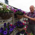 Trevor Gamblin with some of the 60 flower baskets he tends at his Lochlea home.