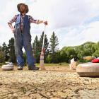 Jock Scott and dog Jack survey Naseby's Centennial Pond for prospects of a bonspiel. Right: The...