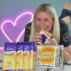 Former Cadbury worker Megan Fairley sells the last 20 blocks of Dunedin Caramilk, plus a 1kg slab...