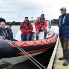 Coastguard Dunedin president John Campbell (right) with other members (from left) Scott Turner,...