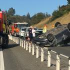 A car ended up on its roof after rolling on the Dunedin Southern Motorway this morning. Photo:...